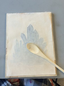 Hand printing using a spoon for pressure