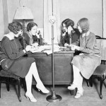 Women sitting at a desk in a room, talking on telephones during a Mississippi River flood relief fund drive.  Chicago Daily news  1927.http://www.theatlantic.com/technology/archive/2013/09/when-dumb-phones-were-cool-a-visual-history/279274/