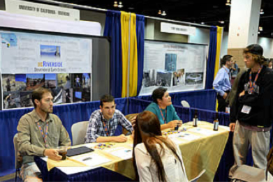 Students inquiring about a school at their exhibition room booth. (Image obtained from www.geosociety.org)