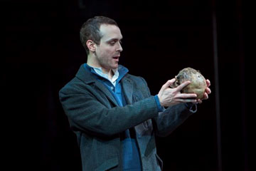 The figure of Hamlet holding the skull of Yorick from a production of Hamlet performed at the Denver Center Theater Company. Taken from the Denver Center. http://extras.mnginteractive.com/live/media/site36/2014/0212/20140212__20140214_C1_AE14THREVIEW~p1.jpg