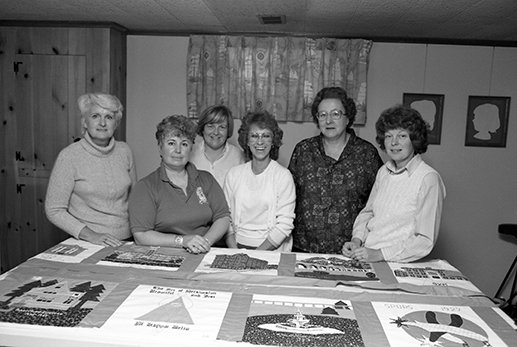 Depicted here are the quilters who created the amazing Centennial Quilt. They are, from left: Joanne Neff Cross '53, Renae Paine '76, Liz Gallo, Rose Henry, Kathleen Weidkamp Peterson '67, and Karen Peterson Finney '67.