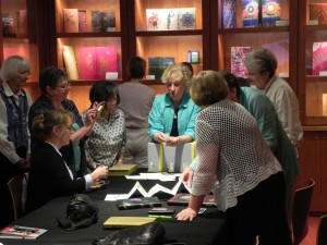Cynthia Sears presents some of the books from the Museums Collection to members of the Puget Sound Book Artists.