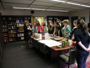 Jane Carlin speaks to a Girl Scout troop in the rare books room of Collins Memorial Library the evening of the reception for the PSBA Member's Exhibition. photo credit: Mark Hoppmann
