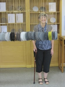 Curator Lucia Harrison stands with her work, Ancient Forests of Frying Pan Creek at Collins Library