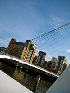 The Gateshead Millennium Bridge is a tilt suspension bridge that literally rotates up to let boats under. SO COOL!