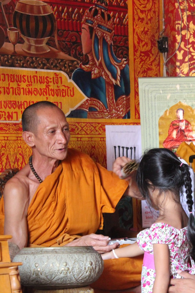 Monk blessing a child