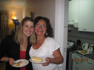 me and my host mom Gladys enjoying the cake