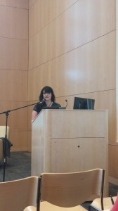 Ms. Valente giving her keynote address to a packed audience in the Tahoma Room of the University of Puget Sound.