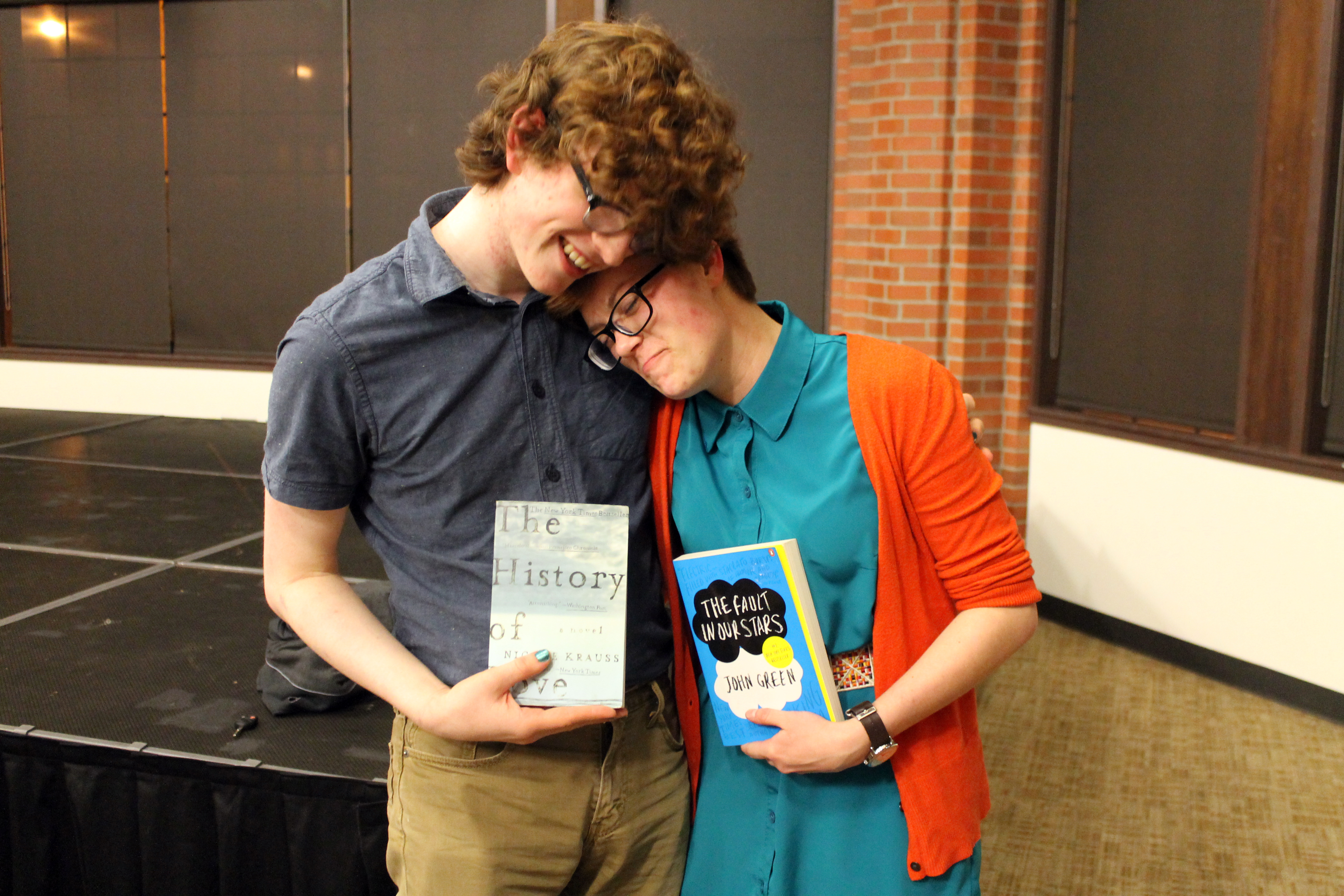 Chris Kelly and Nicole share a moment with their new books