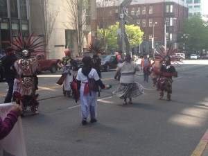 Aztec dancers marching through downtown Seattle with the Caravana