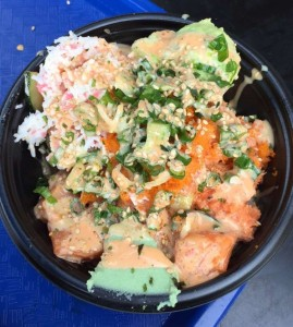 This bowl has salmon, crab, spicy mayo, sesame seeds, green onions and fish eggs on sushi rice