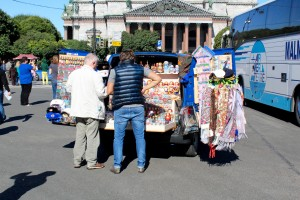 A vendor selling Matrushka dolls, scarfs, and other stuff to tourists outside The Peter & Paul Fortress in the City Center of St. Petersburg, Russia.